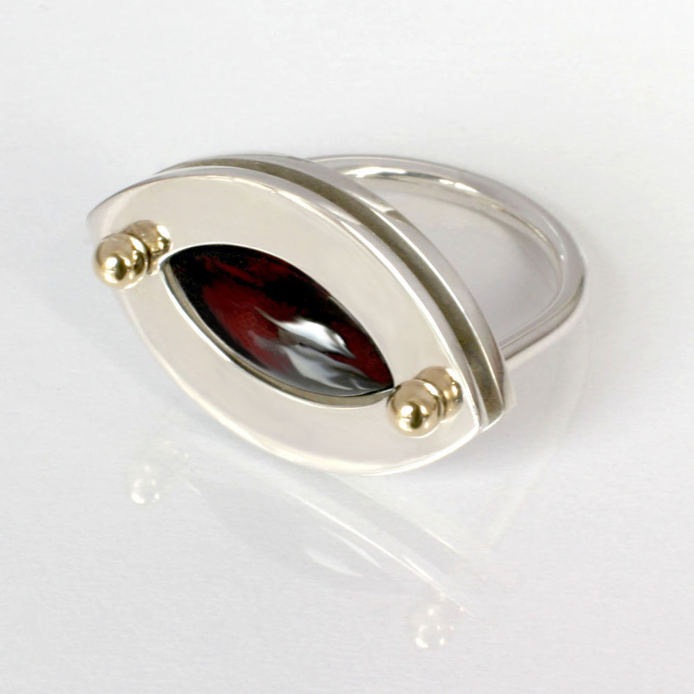 12 ring silver 18 ct gold details garnet.jpg