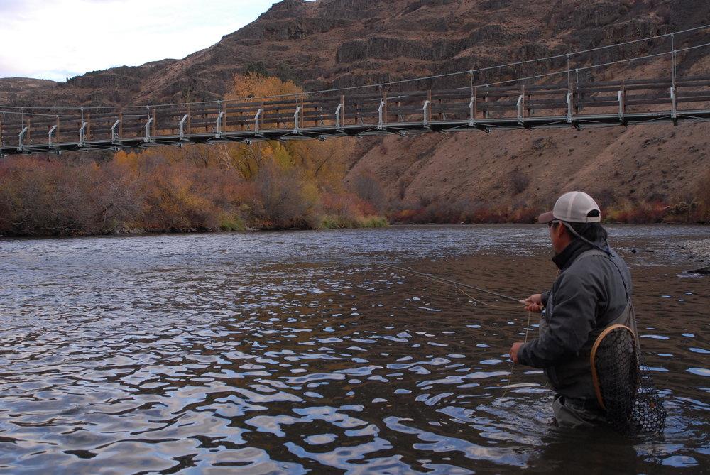 Todd Fuchigami wading Yakima River
