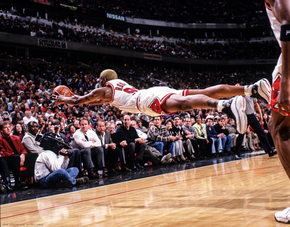 Chicago, IL - Dennis Rodman #91 of the Chicago Bulls goes horizontal during an NBAgame with the Golden State Warriors at the United Center on February 22, 1997. Manually focused Hasselblad, RDP 100 film, arena strobe lighting.  Sam Forencich ©1997 NBAE