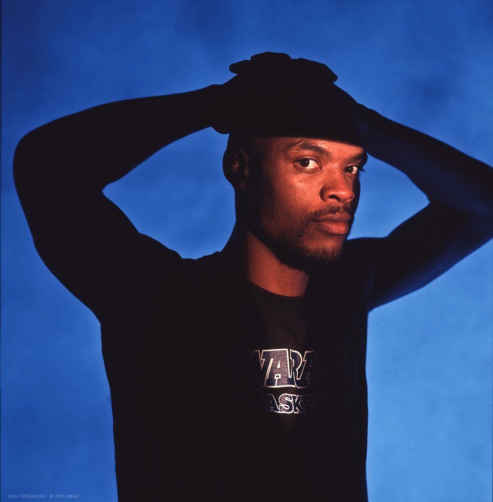 Oakland, CA - Latrell Sprewell #15 of the Golden State Warriors poses for a portrait circa 1995 at the Oakland-Alameda County Coliseum Arena. Manually focused Hasselblad, RDP 100 film, studio lighting.  Sam Forencich ©1995 NBAE