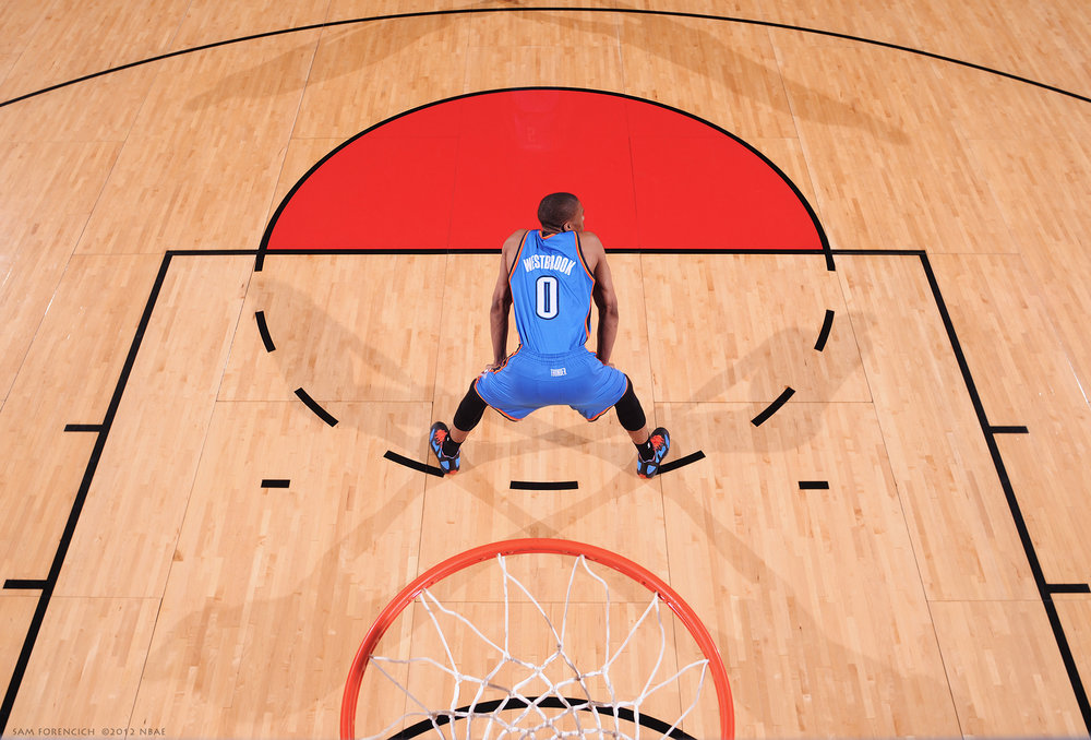 Portland, OR - Russell Westbrook #0 of the Oklahoma City Thunder catches his breath during the game against the Portland Trail Blazers on March 27, 2012 at the Rose Garden Arena. Digital 35mm remote camera, arena strobe lighting.  Sam Forencich ©2012 NBAE