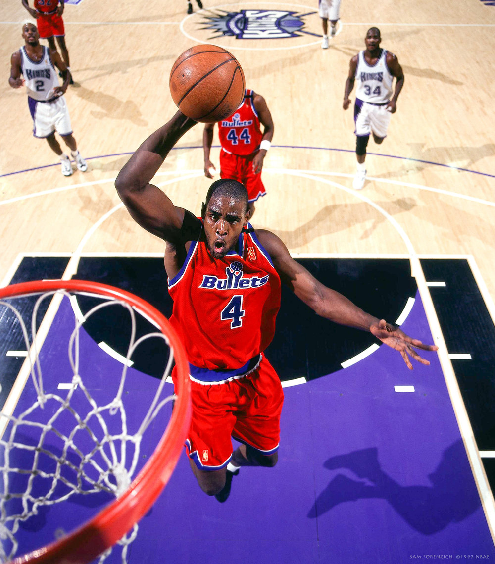 Sacramento, CA - Chris Webber #4 of the Washington Bullets goes for a dunk against the Sacramento Kings during the NBA game at ARCO Arena circa 1997. Hasselblad remote camera, RDP 100 film, arena strobe lighting.  Sam Forencich ©1997 NBAE
