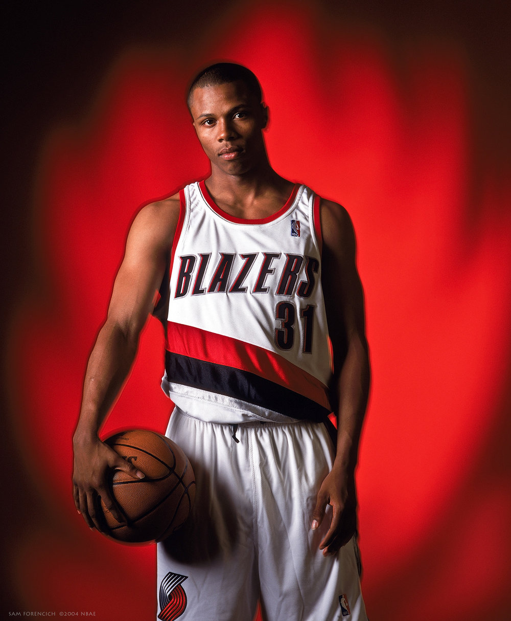 Portland, OR - Sebastian Telfair #31 poses for a portrait in conjunction with the Trail Blazer's introductory press conference for their 2004 NBA Draft selections at Rose Garden on June 28, 2004. Manually focused Hasselblad, RDP 100 film, studio lighting.  Sam Forencich ©2004 NBAE