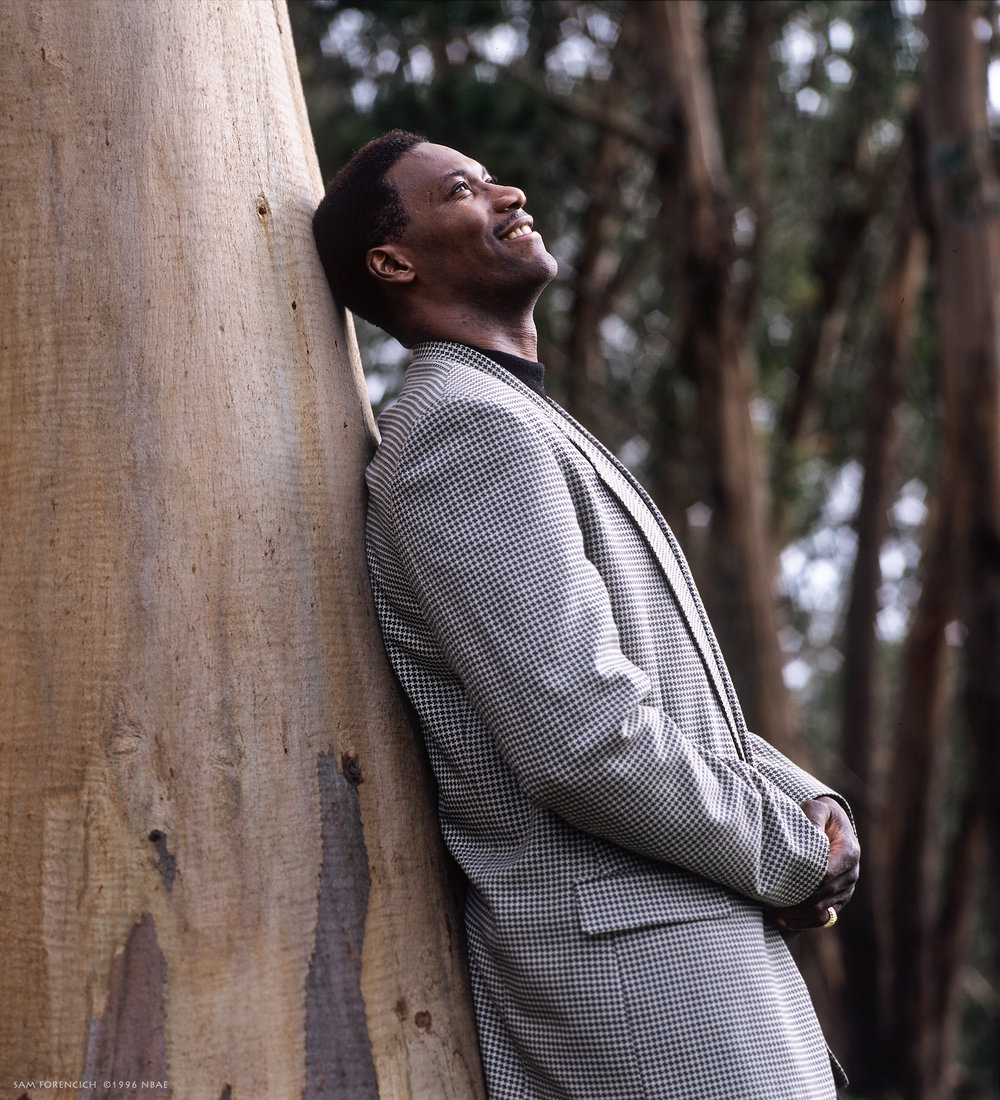 San Francisco, CA – Jerome Kersey of the Golden State Warriors poses for a portrait in a eucalyptus grove on Treasure Island circa 1996. Manually focused Hasselblad. Natural light.  Sam Forencich ©1996 NBAE
