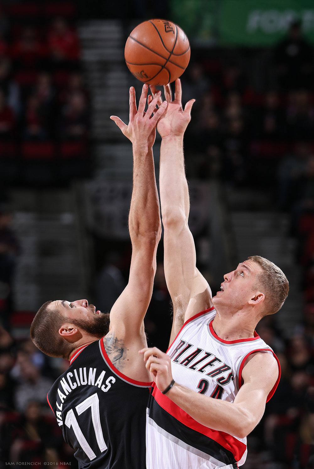 Portland, OR - The opening tip off between Jonas Valanciunas #17 of the Toronto Raptors and Mason Plumlee #24 of the Portland Trail Blazers on February 4, 2016 at the Moda Center. Digital 35mm, arena strobe lighting.  Sam Forencich ©2016 NBAE