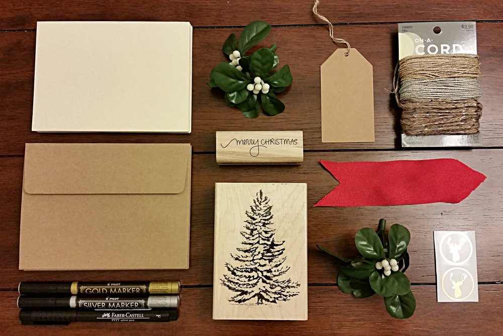 Materials: Ivory card set // Blank envelopes // Gold and Silver Marker set // Tree stamp // Holiday stamp // Jewelry Cord // Deer stickers