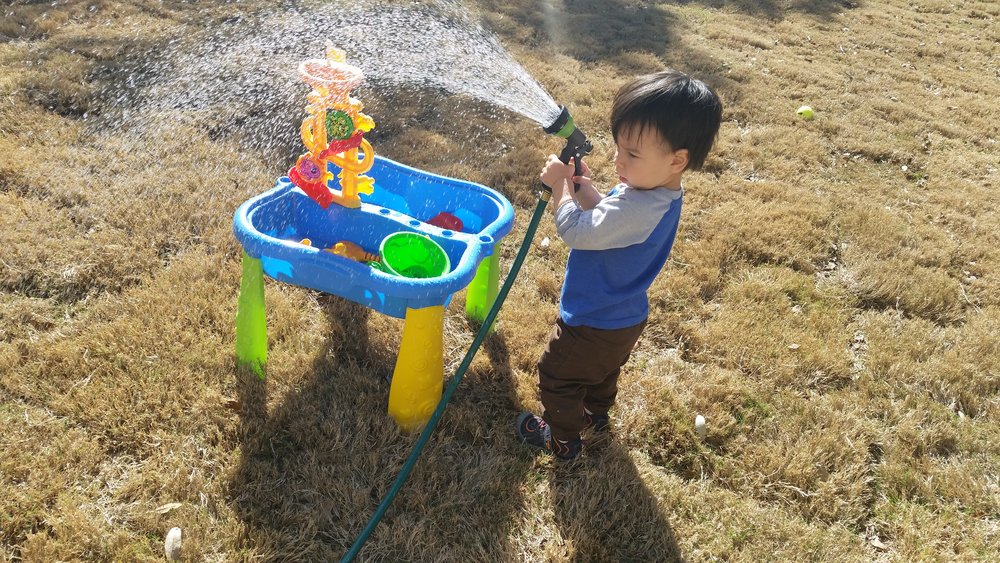 "Ezra ""watering the grass"" and his playstation..."