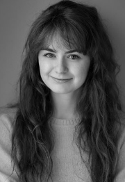 Bebe Barry -Hannah: Bebe Barry  Here's the new bio:After training at LAMDA, Bebe has performed in several productions with Dalmatian Theatre Company, playing  Borachio and  Friar Francis in ' Much Ado About Nothing,'  Laura in ' Chatroom' at the White Bear Theatre and  Puck in ' A Midsummer Night's Dream.' She is a member of the National Youth Theatre and has recently founded Exploding Whale Theatre, writing and starring as  Billie in their debut show  'Heroes' which debuted at Katzpace and has since gone on to sell out runs at the Edinburgh Fringe Festival and Bridge House SE20. This will be Bebe's second show with Lidless after playing  Lil in  'The Wasteland.'