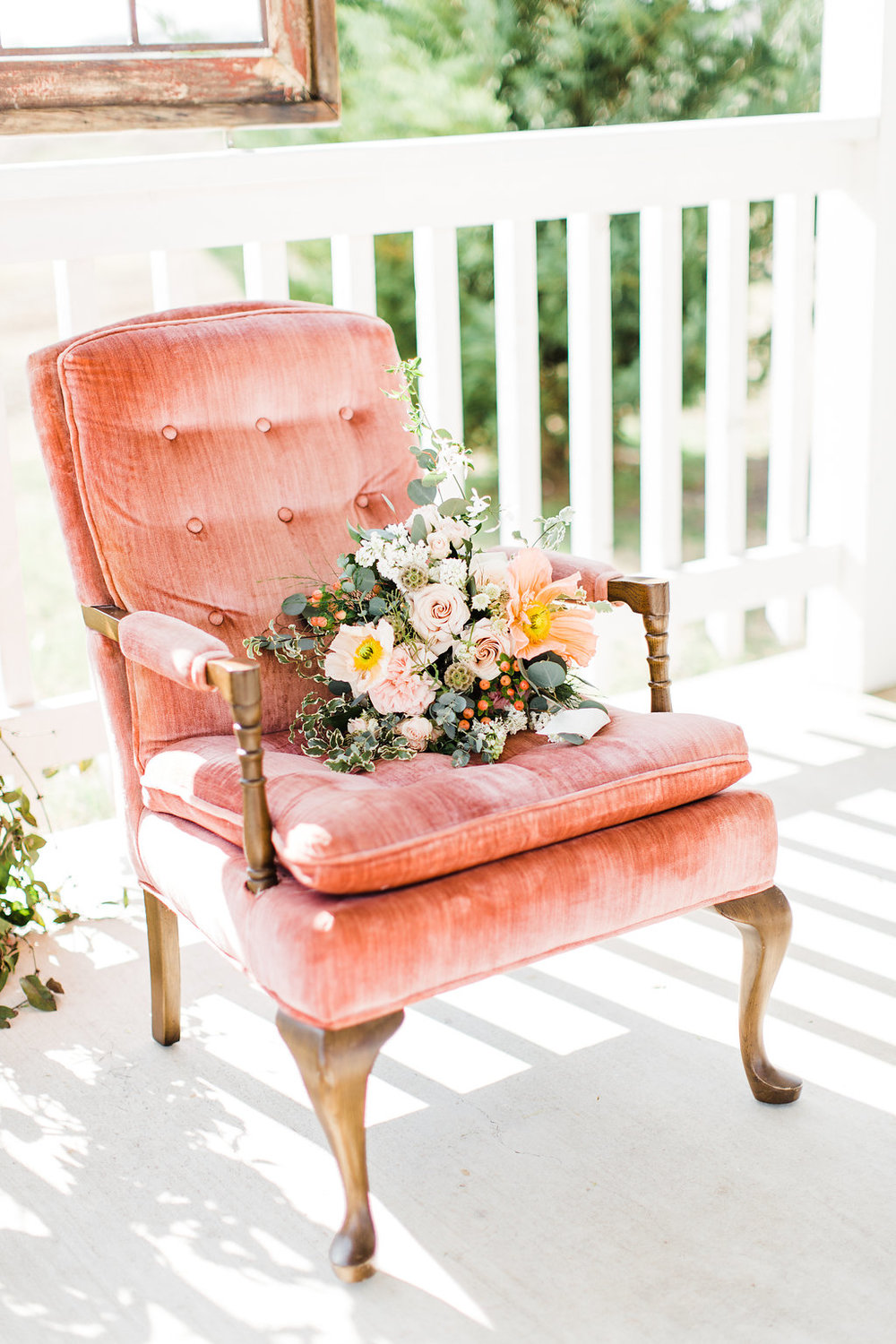wedding bouquet green and orange on old chair