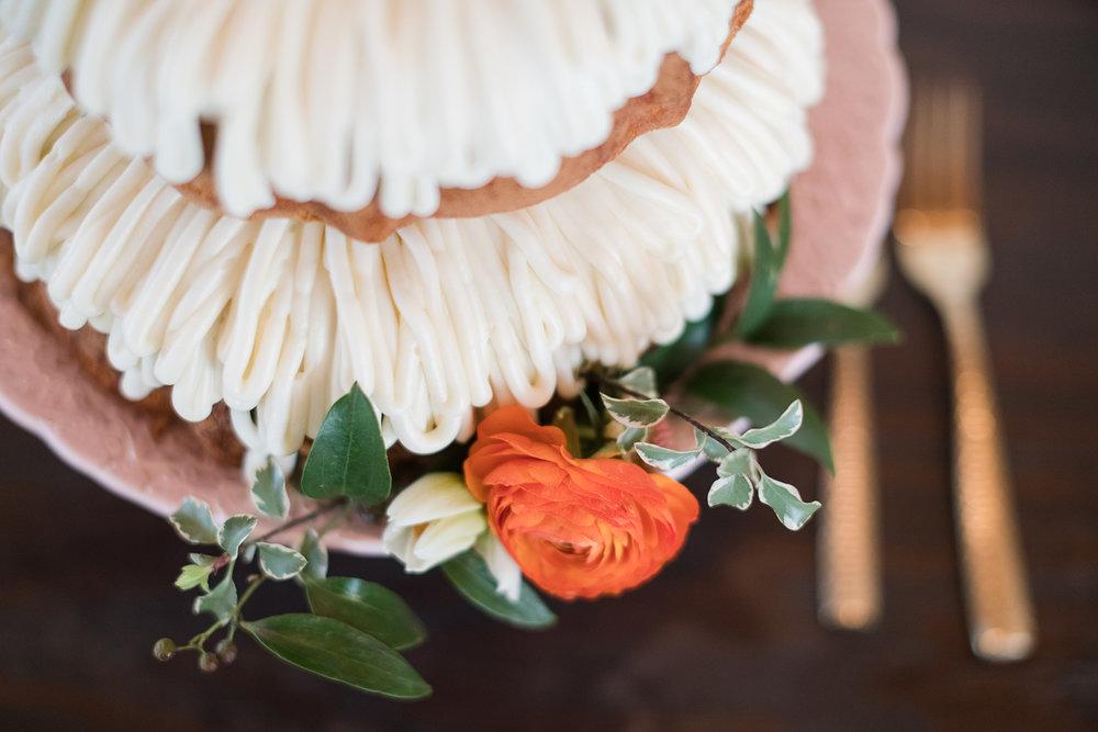 wedding bundt cake greenery and orange