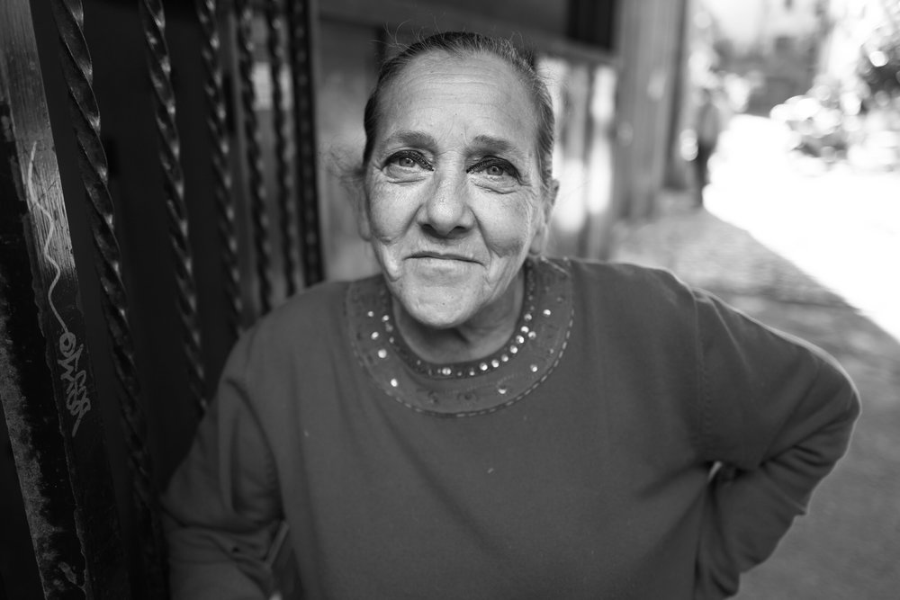 A Street Portrait taken in the district of Sal Lorenzo in Rome. Aperture f2,0 @ 500 iso. Ambient light.