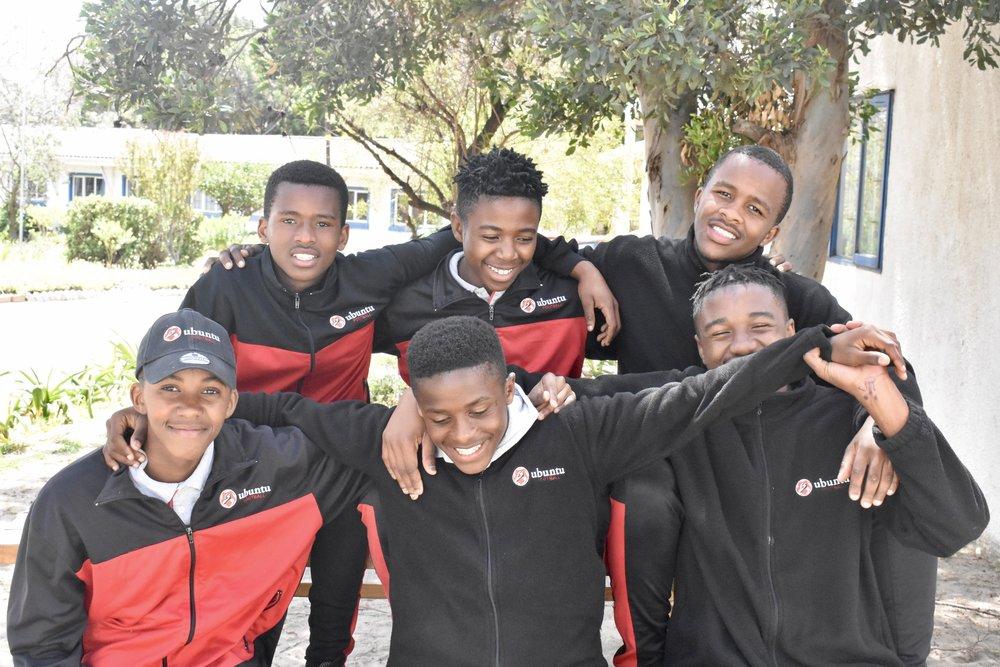 L to R: (back) Siya, Azola, Ase (front) Somila, Jimmy, Bongani