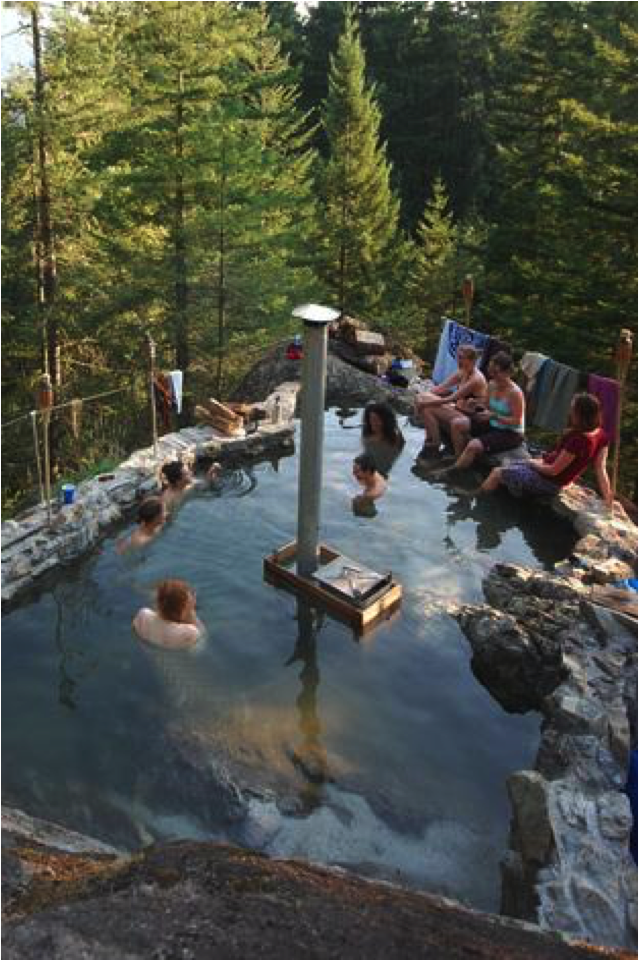 "Revival participants basking in ""Little Rock"" - a wood-fired hot tub built into the side of a granite cliff."