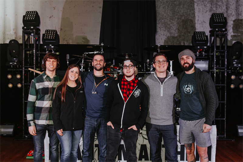 PMC host, Sarah Hagan and Winner, Bobby Laflamme with drummer Matt Greiner and the rest of August Burns Red.