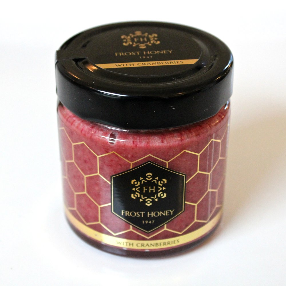 Frost Honey - With Cranberries - $14.99 Due to its natural characteristics, the cranberry usually requires a sweet companion. The piquancy of honey is a true compliment to the capricious little red berry. These two ingredients come together and draw the distinction between taste and flavor. Savor the seductive balance by spoonful. Freeze-drying is one of the best ways, besides eating the fresh cranberries, of keeping it in a preserved form. This is a gentle process of removing water from the berry in a low temperature state, while retaining its structure and nutritional value. One jar of Frost Honey contains 4-5 ounces of fresh ripe cranberries for you to enjoy.