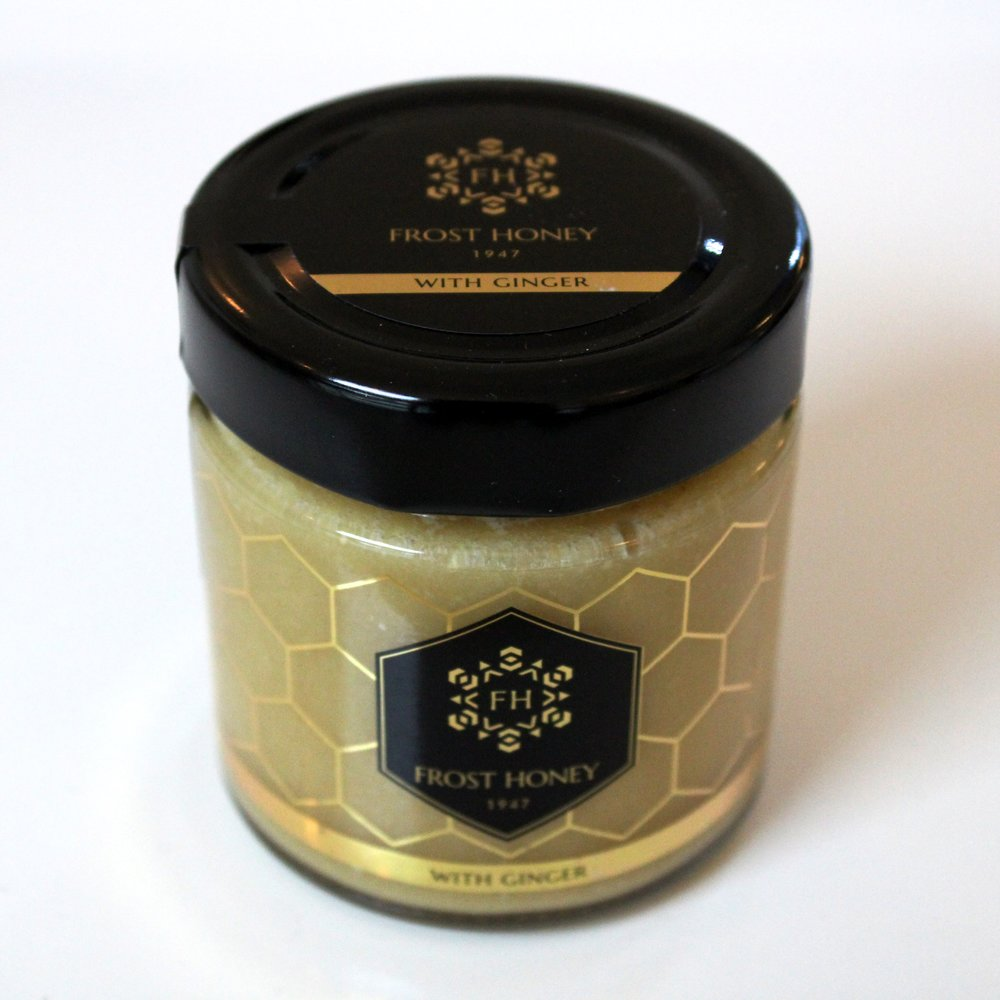 Frost Honey - With Ginger - $14.99 Ginger has a distinctive taste and aroma. Its lively personality comes from the warm, peppery notes and relaxing properties. The mixture with natural honey begins sharp and invigorating, but ends in a soughing sweet aftertaste. Each bite offers a bit of something different. Sample the unique sensory experiences by a spoonful. Freeze-drying is one of the best ways, besides eating the fresh ginger, of keeping it in a preserved form. This is a gentle process of removing water from the root in a low temperature state, while retaining its structure and nutritional value. One jar of Frost Honey contains 4-5 ounces of fresh-cut ginger for you to enjoy.