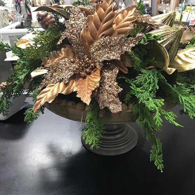 ''Tis the season to play around with florals. This is a cake stand we designed an arrangement on.