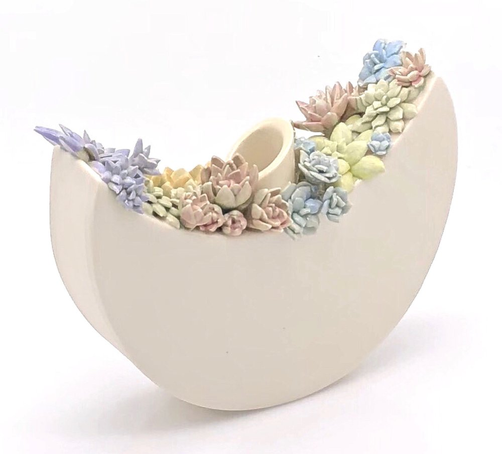 6_Rocking_Vessel_Encrusted_with_Pastel_Succulents.jpg