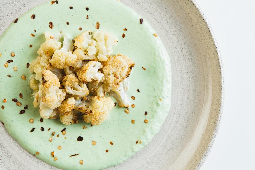 roasted cauliflower on green tahini.jpg
