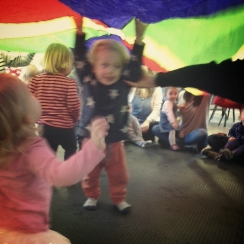 Oscar getting over excited about the parachute at music class and literally being dragged out by the teacher