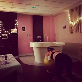 Hypnobirthing Place mum Nina in the birth centre with her affirmations up, fairy lights, scarf under her and calming room spray. A lovely birth cave!