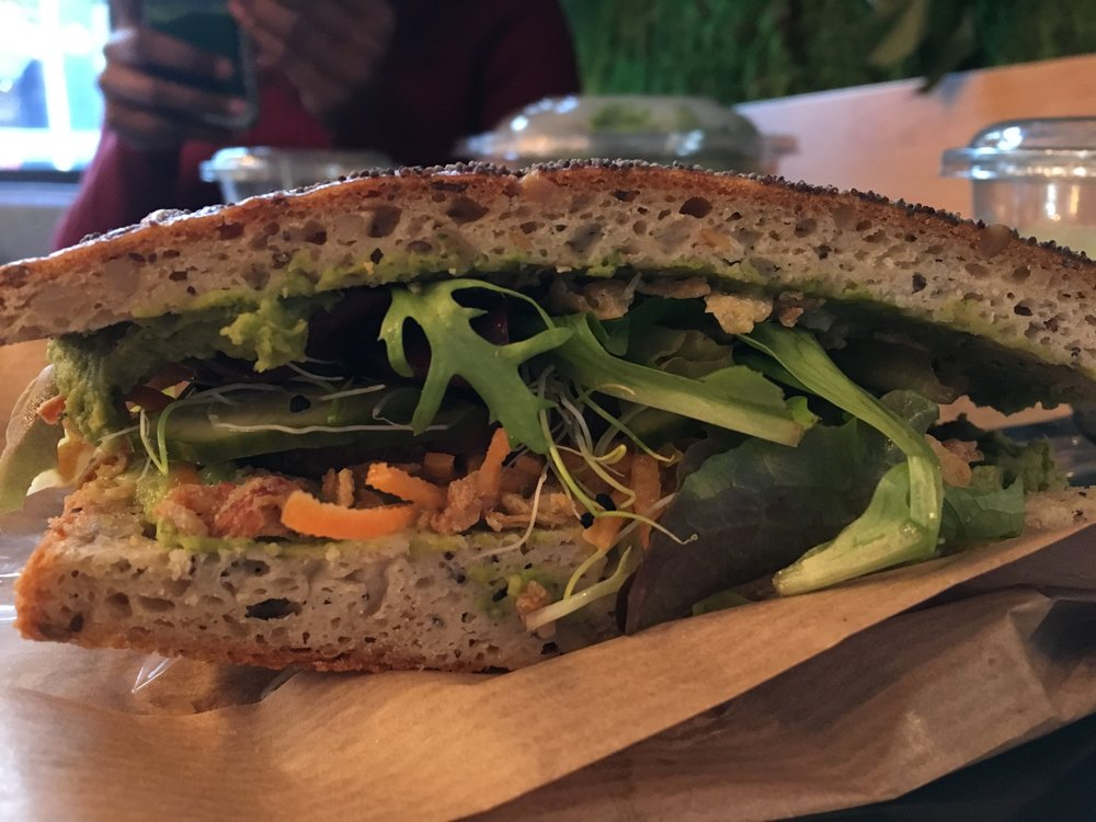 Vegan sandwich with hummus, avocado, and roasted tofu!