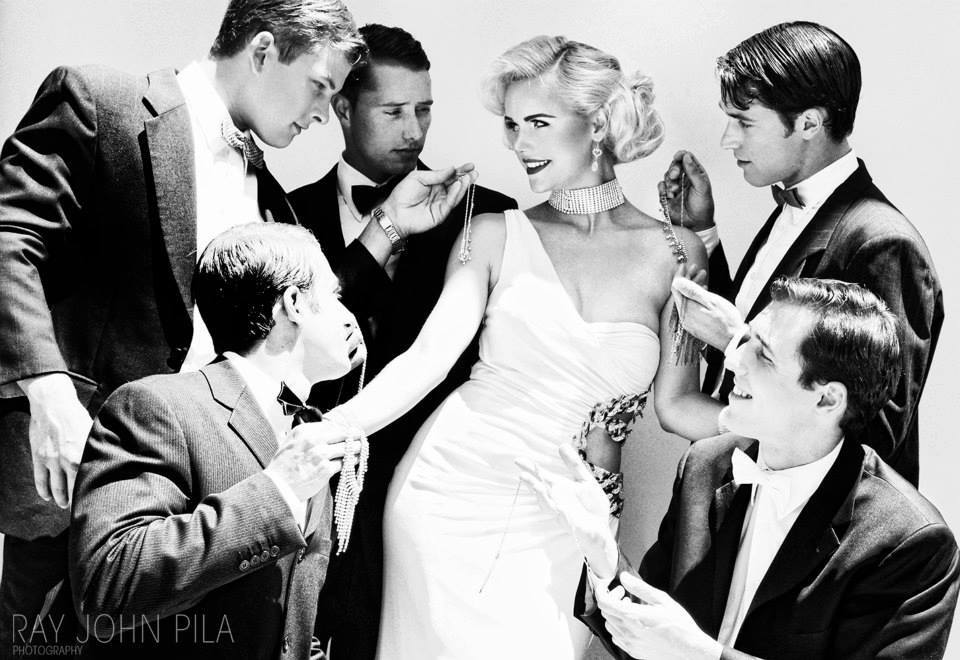 Nicolette Holman as Marilyn Monroe surrounded by admirers offering her diamonds