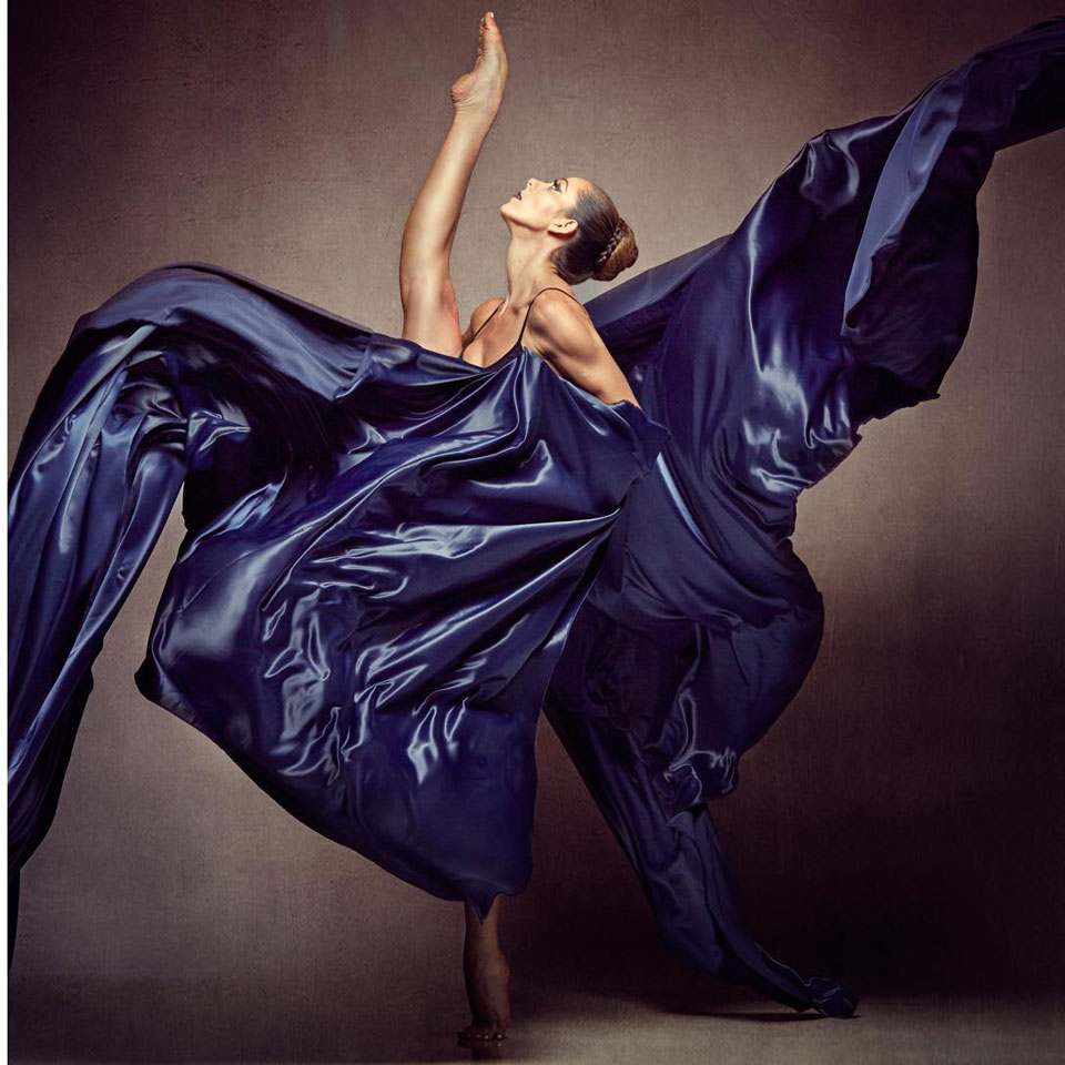 Elegant Ballerina with Billowing Blue Fabric