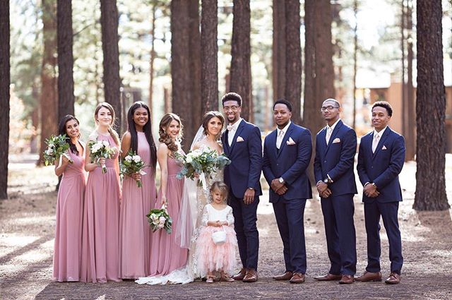 Picture perfect wedding party... even down to the cute Lil Wild-flower girl. Cheers to beautiful memories with amazing new friends/family!