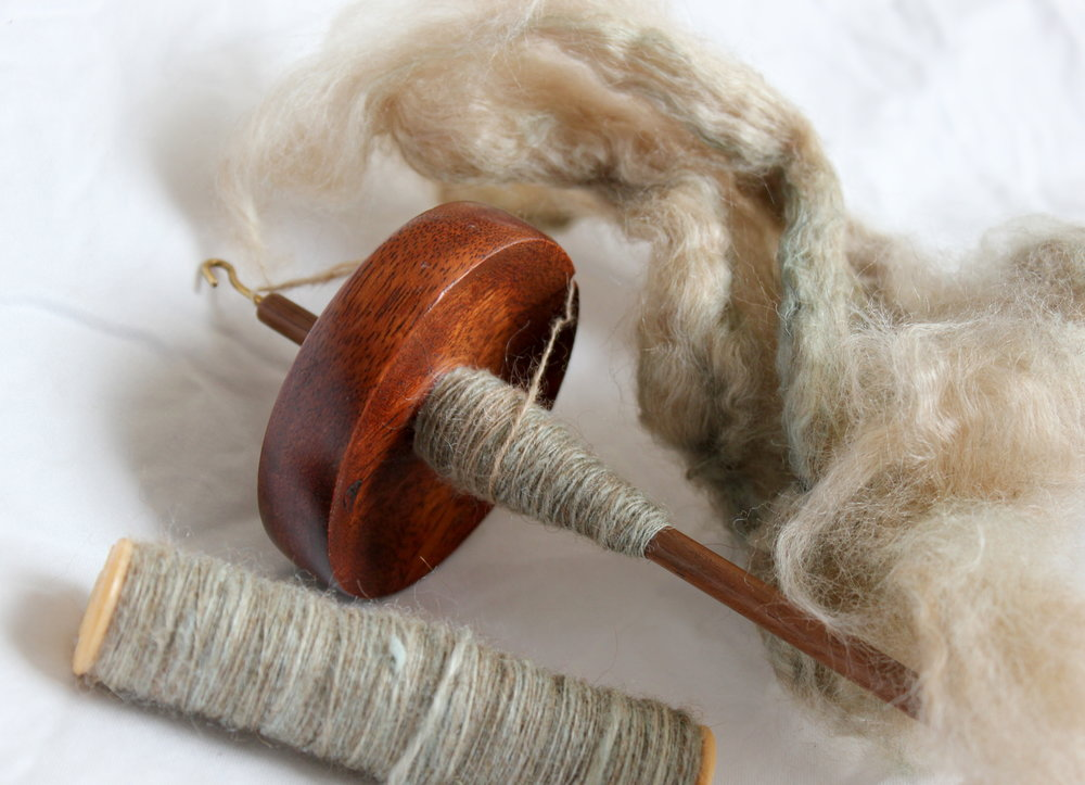 Drop spindle with camel hair fiber and yarn