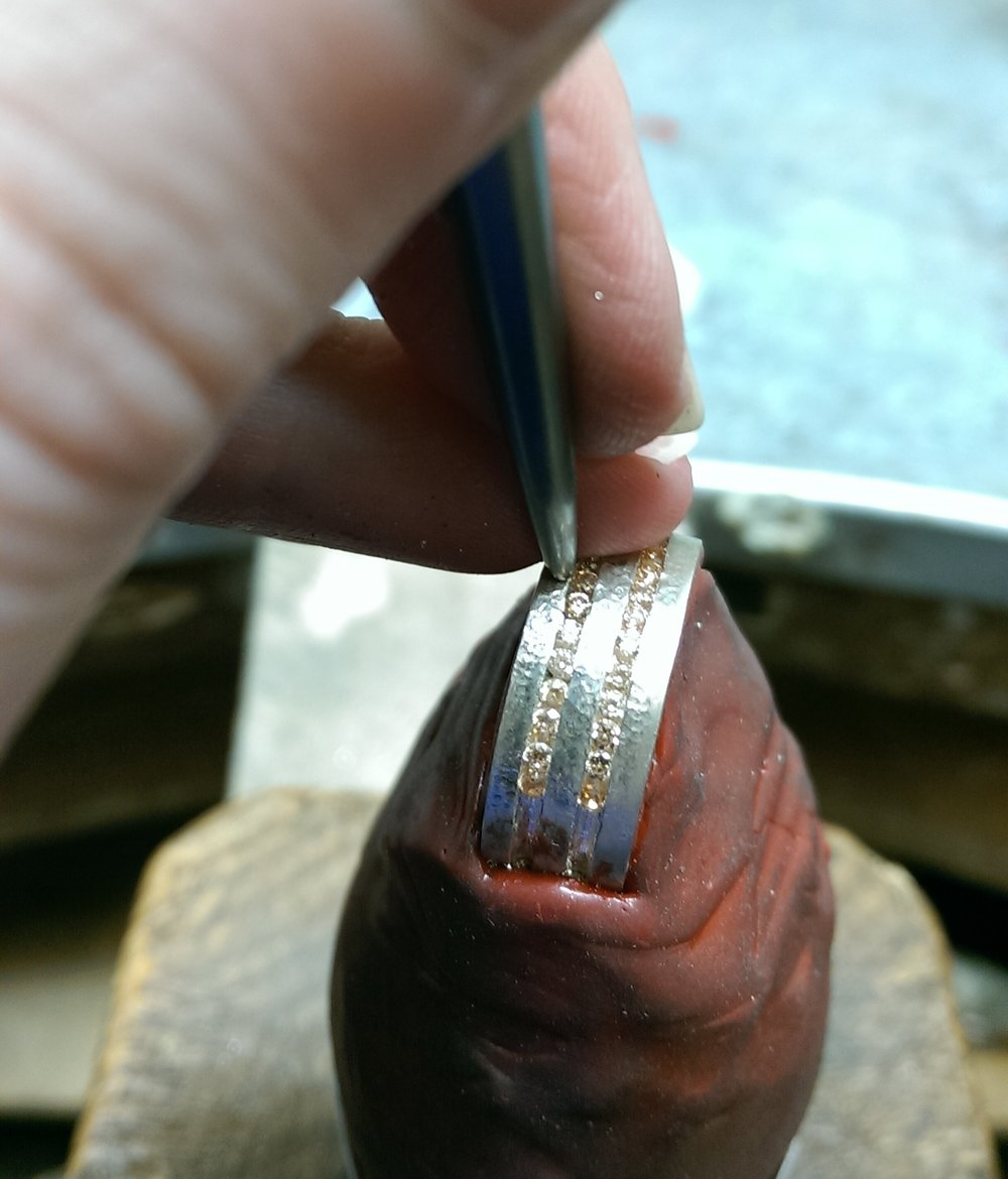 Setting a double row eternity ring with Champagne Diamonds