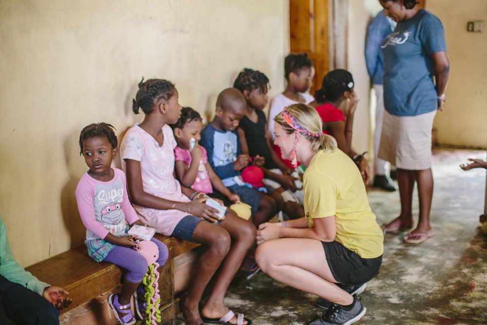 Zofia hands out soaps to children at Fosa Orphanage. Image: Courtney Apple