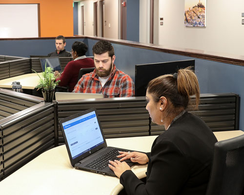 Coworking space - Tired of working at the coffee shop? Connect with other professionals and enjoy our amenities.