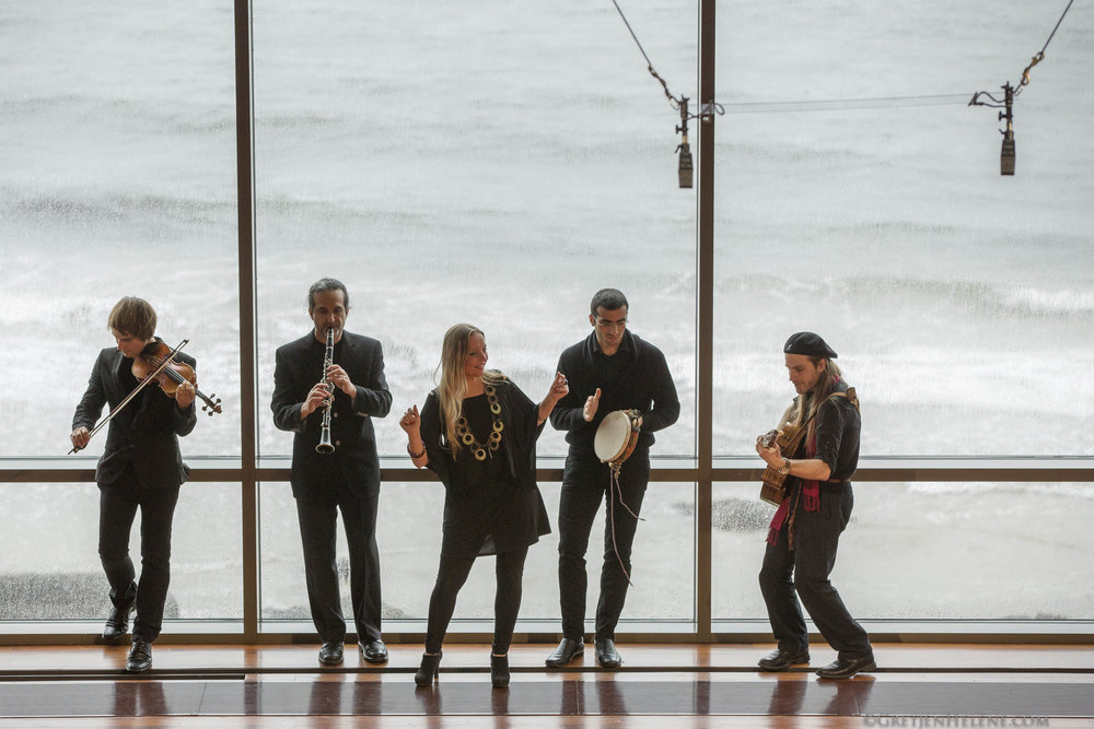 *(A)_CROP_Band-action-shot-with-the-sea-(lose-the-mics-).jpg