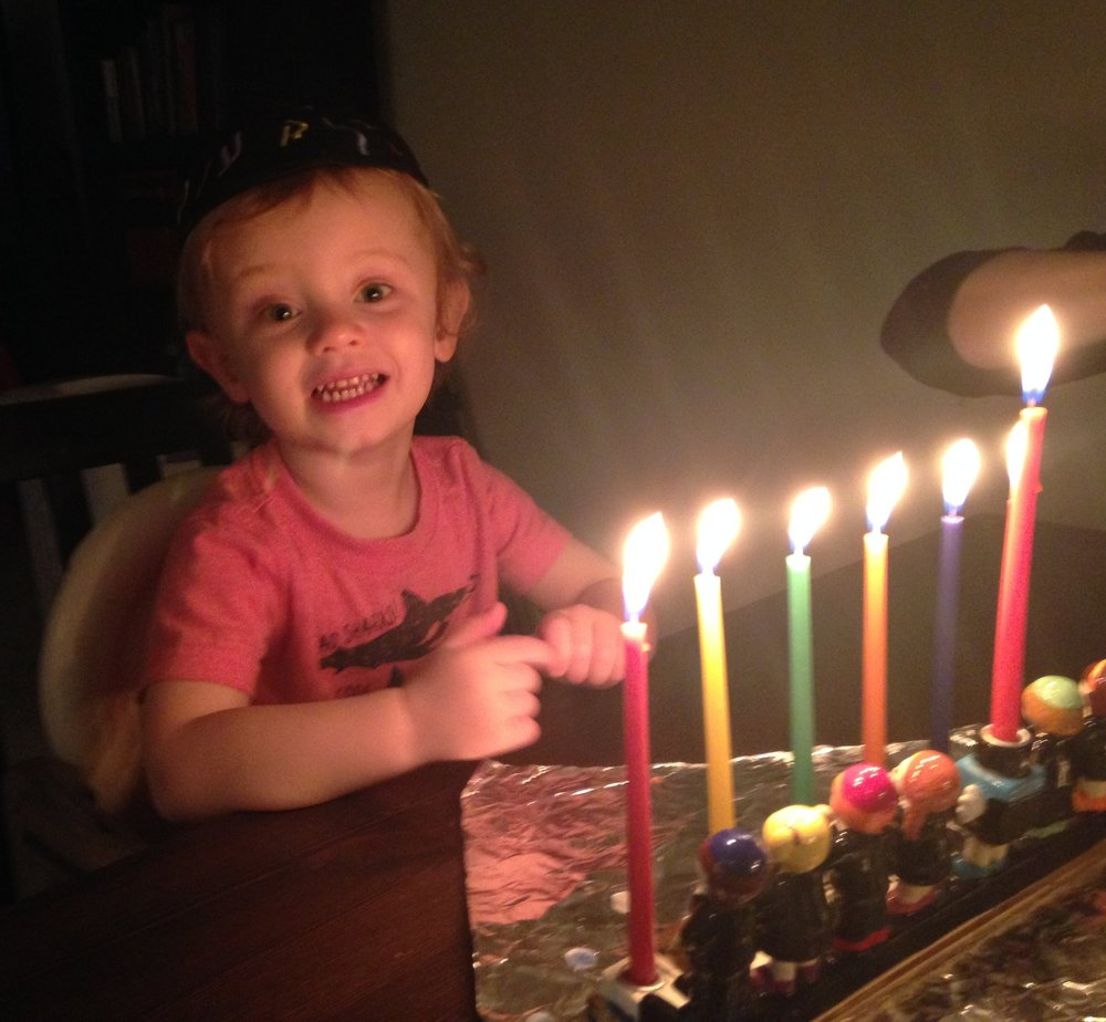 my little guy enjoying his second Hanukkah