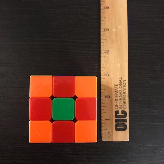 rubix cube game for mild enjoyment and ultimate frustration. #plasticarchaeology #orange #green #red #cube #rubixcube #square #flowerpattern #impossible