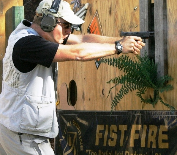 FIST-FIRE Instructor Rick Simes Double Taps Target at TSA Nationals. Note how the gun is in FULL RECOIL and there are (2) empty cases in the air. That's RECOIL CONTROL from the F.R.O.W.L. = Fully Rolled Over Wrist Lock, a trademark of the Fist-Fire System.