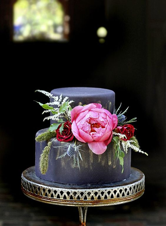 I really love the contrast of the black fondant covered cake. Especially with vibrant florals!