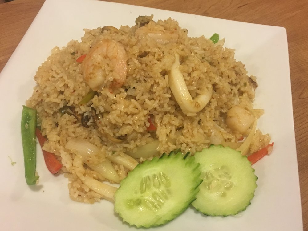 Ya-Lay Fried Rice : spicy fried rice with shrimp, calamari, scallops, muscles, crabmeat, onions, bell peppers, chili peppers and basil