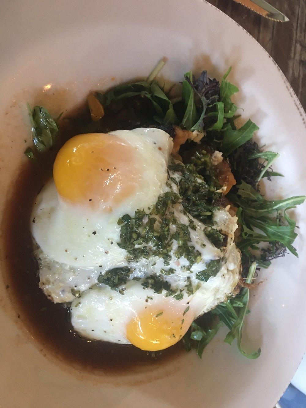 Braised Short rib over cheese potato cake & Mizuna Green, farm fresh egg, shaved fresh horseradish, and House made chiimichurri