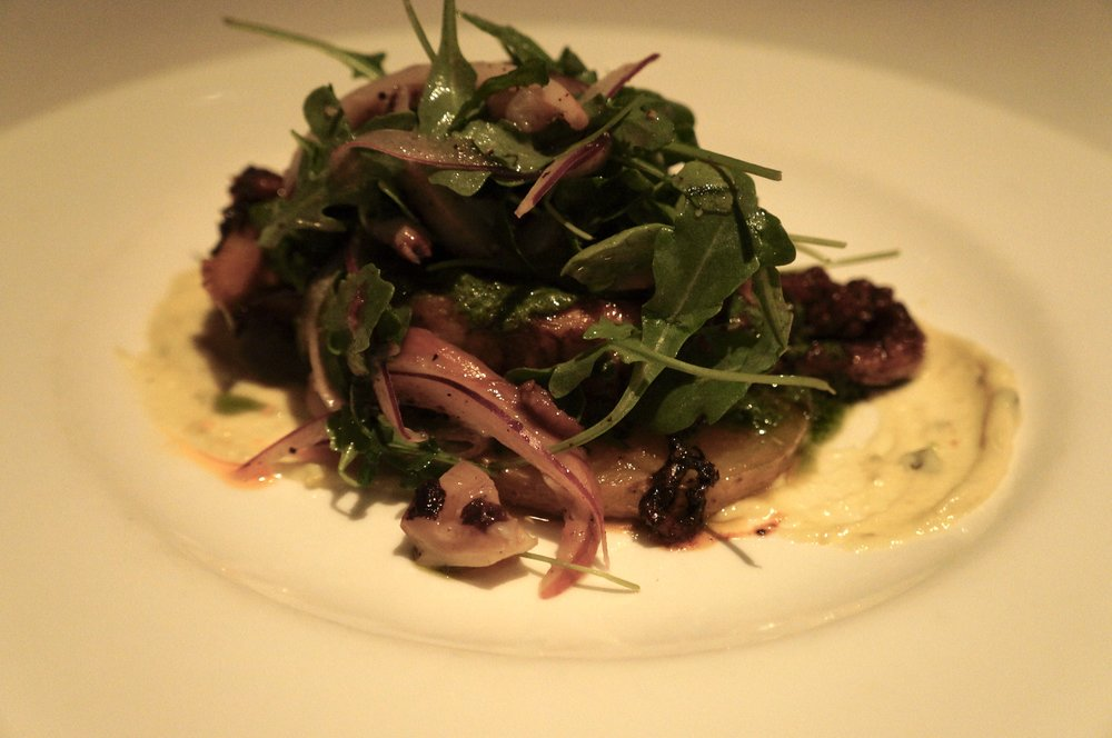 Polpo alla Griglia  Wood grilled octopus with olive oil braised potatoes, salsa verde, Tonnato sauce and arugula pickled red onion insalatina