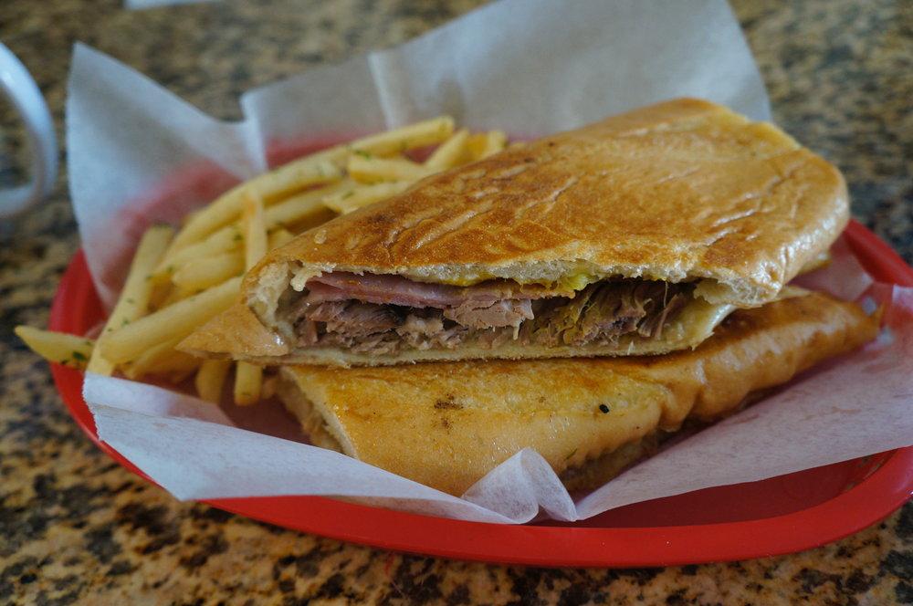 Cubano Classico : Lechon Asado (slow roasted pork), ham, Swiss cheese, mustard, pickles, mojo
