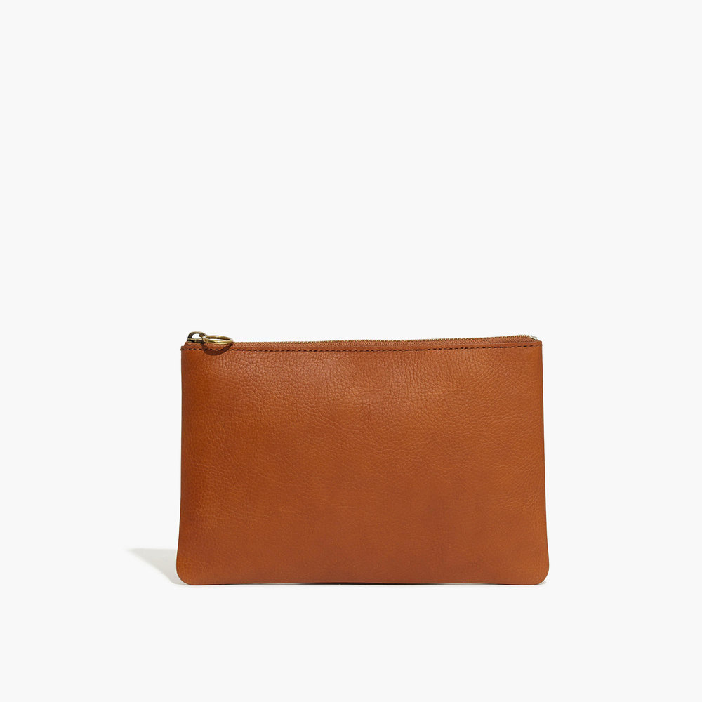 This beautiful   Leather Pouch.   I love Madewell! I purchased a leather purse from them over three years ago and I still get compliments! I have used it so much that it has that beautiful broken in look. But it is so sturdy because it is good quality product that is made well. (pun intended)