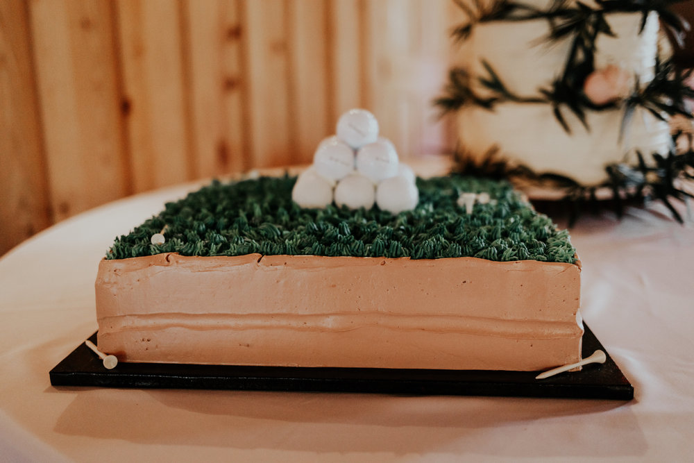 The grooms love of golf was celebrated with his cake- a surprise to him!