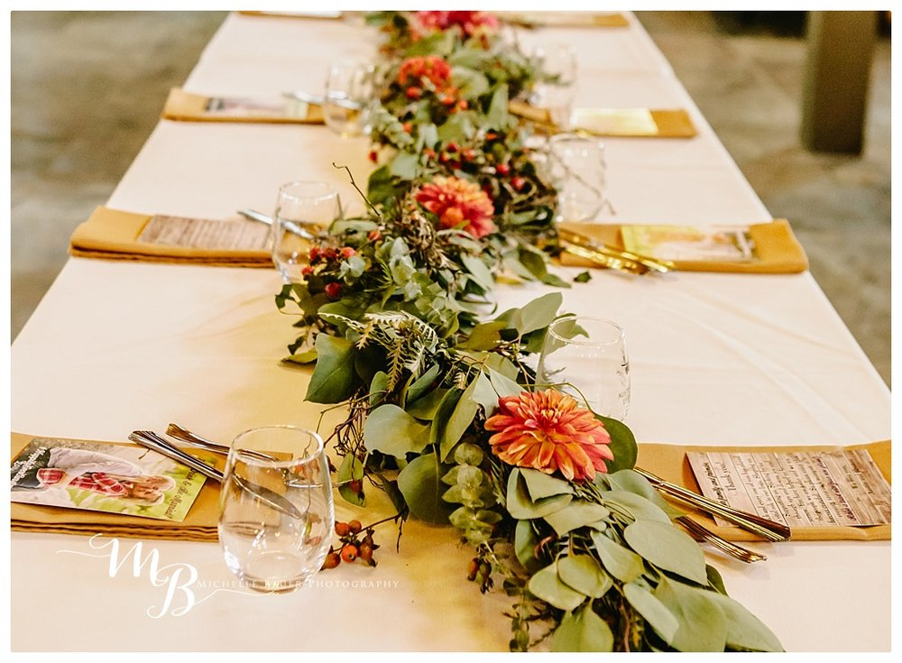 The wine glass is a gift for the guest and These great garlands were created by  Summer Robbins Flowers
