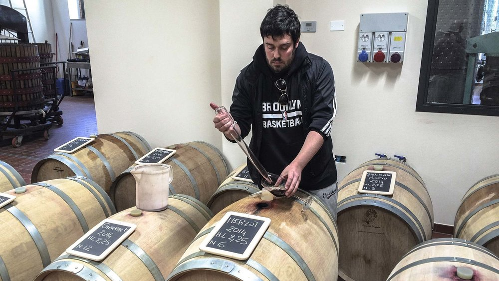 Diego tests different vintages during the aging process