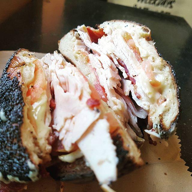 The Turkey Bacon Melt.  Smoked turkey breast, crispy bacon, grilled Swiss cheese and tomato.  #maxbagels #foodporn #bagels #breestreet #capetown #turkeymelt