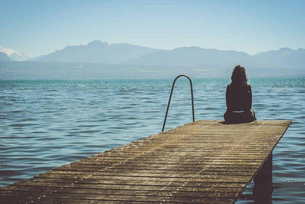Female sitting by the lake.jpg