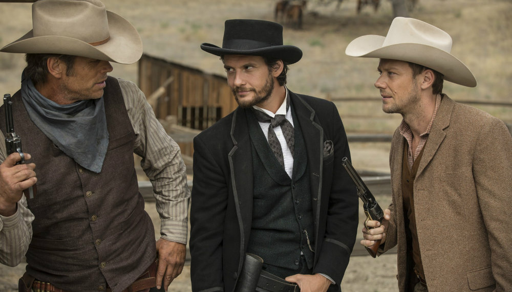 Ben Barnes (middle) as Logan and Jimmi Simpson (right) as William interacting with an android host (Image credit: HBO)