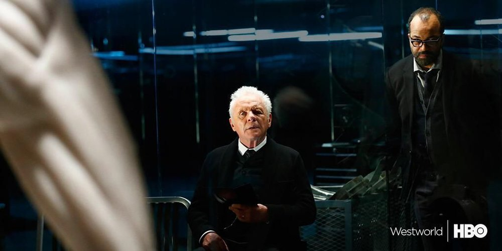 Anthony Hopkins as Robert Ford, flanked by Jeffrey Wright as Bernard (Image credit: HBO)